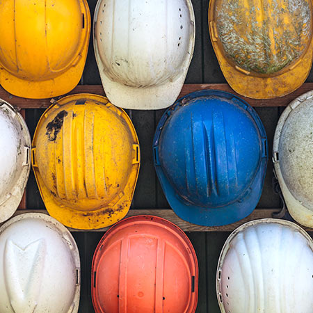 Hard Hats hanging on a wall